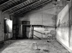 Solitude! (henryark) Tags: blackandwhite monochrome monoart blackwhite dirty dark light shadows room stool wood electric cable windows shelf iron steel rusty old vintage factory solitude enrico nannini henryark nikon nikond750 fullframe industrial abandoned tuscany italy dust floor roof beams walls moldywalls