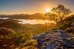 The world stands still. It's just the sun that goes round (huddart_martin) Tags: sunrise mountains lakes view scenic beautiful landscape nature forests tree sun light norway norge holsnøy hordaland rock colours rays shadows wow