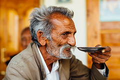 Wrinkled Man Sipping Tea From Saucer (AdamCohn) Tags: adam cohn gadhada gujarat india chai man oldman saucer tea wrinkles wwwadamcohncom adamcohn drink drinking