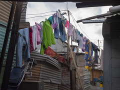 Dramatic Clothesline in shack town at dump (jimbobphoto) Tags: poverty color trash poor clothes shack clothespole