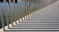 Fifty Shades (Jac Hardyy) Tags: bridge light shadow water metal architecture concrete licht wasser steel rail shades symmetry architektur rod brcke rohr rods metall schatten stainless beton stange fifty gelnder rohre symmetrie stangen edelstahl highgrade