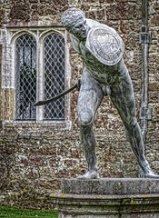 The lead cast statue known as the Borghese Gladiator at Knole House in Sevenoaks, Kent, England (mharrsch) Tags: park england house castle statue architecture kent estate realestate palace tudor warrior shield mansion nationaltrust lead sackville sevenoaks gladiator borghesegladiator knolehouse countryestate mharrsch leadcast