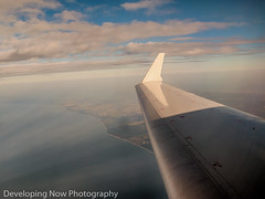 On A Wing & A Prayer (nywheels) Tags: aircraft airplane airplanewing sky land clouds water creative sunrays travel
