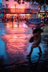 Raining down on the Folies. (Pierre Bodilis) Tags: bar night paris silhouette street umbrella paris19earrondissement ledefrance france fr