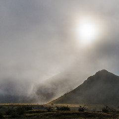 Lindis Pass light (Ian@NZFlickr) Tags: lindis pass light mist sun breaking through hill south island nz
