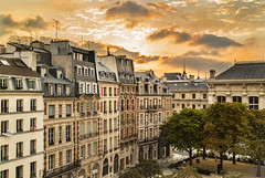 Sunrise over the Place Dauphine (France through my eyes) (docoverachiever) Tags: apartments processed placedauphine buildings orange hdr henryiv hss paris france yellow 1607 architecture park sunrise skyline ledelacit building