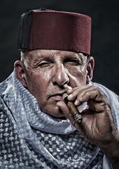 Enjoying a good cigar (Ineke Struk) Tags: fez man morocco cigar old traditional