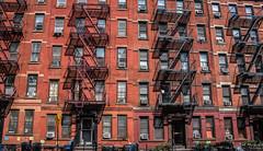 2016 - New York City - Fire Escape (Ted's photos - Returns late November) Tags: tedsphotos tenement tenementbuilding fireescape steps ladders railings redbrick redbrickbuilding streetscene street building shadows windows doors airconditioningunits