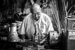 Miller at work (Ludovic Enkler) Tags: cyprus chypre man old blackwhite monochrome 50mm canon f14 tool mechanician mchanicien