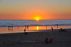 Sunset over the ocean (yonca60) Tags: spain conildelafrontera cadiz atlanticocean ocean sunset scenery beach lowtide sea water people mare atlasokyanusu okyanus sun sunsetovertheocean ispanya reflection shadow sand plaj
