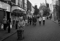 2016_288 (Chilanga Cement) Tags: fuji fujix100t fujixt1 x100t xseries x100s x100 bw blackandwhite church ormskirk churchstreet lady trolley shop shops shopping