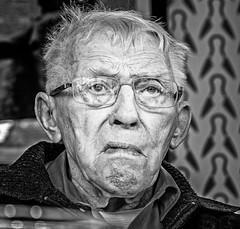 Portrait (Den) (BW) (Olympus OMD EM5II & mZuiko 12-40mm f2.8 Pro Zoom) (markdbaynham) Tags: bw face people portrait elderly olympus omd em5 em5ii csc mirrorless evil mft m43 m43rd micro43 micro43rd zd mz zuiko zuikolic mzuiko 1240mm f28 pro zoom