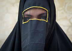 Portrait of an iranian shiite muslim woman with her face hidden by a veil mourning imam hussein on tasua during the chehel manbar ceremony one day before ashura, Lorestan province, Khorramabad, Iran (Eric Lafforgue) Tags: 1people 30s adult adultsonly ashura celebration ceremony chador closeup clothing colorimage covered hidden horizontal hussain imamhussein iran islam khorramabad lookingatcamera middleeast mourner mourning muharram muslim mysterious niqab oneperson onewomanonly outdoors people portrait religion religious ritual shia shiism shiite tasoua tasua tradition traditional unrecognizableperson veiled woman lorestanprovince ir