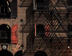 Open those windows (Tigra K) Tags: newyork unitedstates us 2016 architecture balcony color fence iphone lattice rhythm shadow stairs usa window rope texture pattern