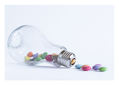 331/366: A light bulb moment (judi may) Tags: 366the2016edition 3662016 day331366 26nov16 lightbulb smarties sweets candies highkey photoborder white whitebackground macro canon7d negativespace simplicity