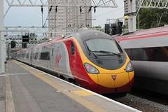 Birmingham bound Pendolino . (AndrewHA's) Tags: street new london station electric train birmingham railway trains class virgin euston 1903 unit 390 pendolino 390148 9g40