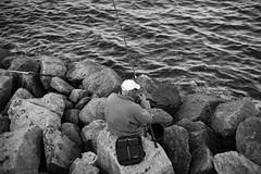 Fisherman (p.dembiermont) Tags: sea fish man hat rock bag 50mm fishing fisherman waves 14 bald nikkor