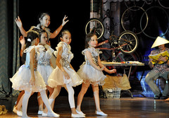 Christmas angels (Roving I) Tags: christmas costumes girls children vietnam sparkle bicycles angels concerts danang conicalhats