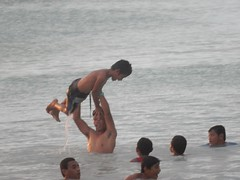 Child on High (mikecogh) Tags: tuvalu funafuti strength play water swimming fun boys holding superiority conquest