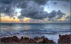 Fluffy Pacific Floaters (tdlucas5000) Tags: clouds sunset oahu hawaii reflections ocean rocks hdr photomatix
