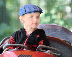 Ready to Roll (DaveLawler) Tags: child kid charlie car hat portrait ride drive driving cap candid