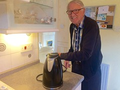Grandad unplugging kettle (Elysia in Wonderland) Tags: grandad ron unplug unplugging kettle socket switch energy saving