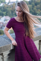 untitled (pass_the_popcorn) Tags: autumn portait dress longhair switzerland windy berne red knitwear popcornphotography girl beautiful woman purple fashion beauty outdoor