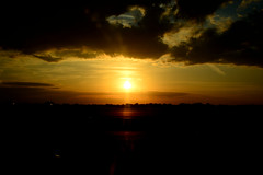 Sunrise At The Airport (Monica.Polladore) Tags: sunrise sun sky clouds morning day sunrays rays airport cloudy