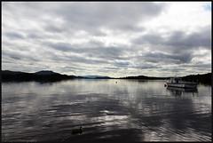 Loch Lomond (anna punx) Tags: scotland summer verano escocia highlands tierrasaltas cloudy nublado cloud nube lago lake loch lomond luss reflection reflejo montaa mountain boat barco azul blue gris grey
