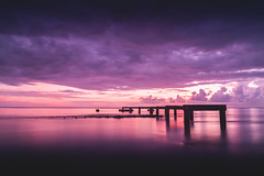 An old tahitian pier on sunset (Sara Fournier) Tags: skies sky ciel rouge flamboyant ponton pier infire fire fireinthesky tahiti tahitian sea ocean pacific poselongue colors filter filtrend nd canon canon6d beach plage polynsiefranaise frenchpolynesia