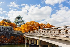 Osaka Castle in Osaka  with autumn leaves, Japan,  landmark of Unesco.; Shutterstock ID 227729509; PO: Hotels.com Korea TVC ad; Client: Hotels.com Korea (Leona) Tags: ancient architecture asia attraction autumn beautiful castle culture decorative defence east emperor famous fortification garden heritage hillside historical honshu imperial japan japanese kansai kyoto landmark leaves medieval monument nature oriental osaka outdoor palace postcard sightseeing sky stone symbol tourism tourist tower travel tree unesco view vintage wall world