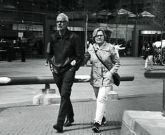 Citywalkers (myphotomailbox) Tags: rotterdam netherlands walk outdoor blackandwhite monochrome markthal city couple manenvrouw photoshop streetphoto hansvanklei mooi