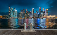 Guardian (Ashley Matthew Teo) Tags: singapore urban marina bay long exposure slow shutter night correction wide angle glow light colourful skyline city cityscape structure skyscrapers buildings architecture cbd central business district financial centre hotels fullerton expensive exquisite shopping road lines trails evening travel tourism modern exploration river water reflection blue dusk outdoor bridge building infrastructure nikon d500 tokina 1116 lee filters