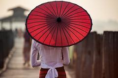 Burmese woman (Sutipond Somnam) Tags: myanmar asia mandalay bein travel burma ubein umbrella girl gold unidentified warm sunrise red burmese bagan people traditional wood woman wooden beautiful bridge asian vietnam cambodia
