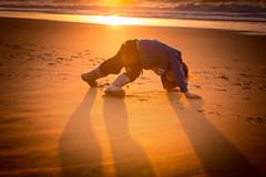 Capoeira? (lermaniac) Tags:  kids sunset beach sea dusk surf waves outdoors boy boots