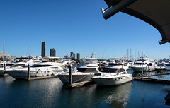 Lots of Dollers Here (Jocey K) Tags: blue sky water architecture marina buildings reflections boats view australia scene queensland yachts surfersparadise goldcoast launches marinamirage triptoqueenslandbrisbane