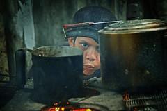 Breathe deeply... (carf) Tags: poverty boy cooking children fire community fireplace child hummingbird smoke blowing forsakenpeople blow shanty rodrigo beijaflor favela slum pans colibri potspans itanham redeculturalbeijaflor kolibriatrisk stovewoodstove