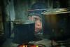 Breathe deeply... (carf) Tags: poverty boy cooking children fire community fireplace child hummingbird smoke blowing forsakenpeople blow shanty rodrigo beijaflor favela slum pans colibri potspans itanhaém redeculturalbeijaflor kolibriatrisk stovewoodstove