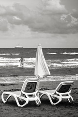 Winter swimming (msiapan) Tags: sea beach monochrome swimming sand cyprus mackenzie larnaca sunbeds