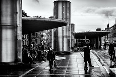 Rainy Mood (Claus Tom) Tags: street blackandwhite bw woman rain weather kids female youth copenhagen bag children denmark kid child candid pipes pipe young streetphotography rainy age cph relationships juvenile climate kbenhavn nrreport ventilationpipes nrreportstation