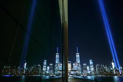 Reflections of the Tribute in Light (BrianEden) Tags: nyc ny newyork reflection water river us newjersey jerseycity fuji unitedstates manhattan worldtradecenter 911 september fujifilm wtc sept11 hudson september11 11th lowermanhattan tributeinlight tributeinlights xpro1