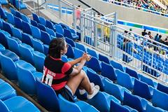 The lonely supporter | A torcedora solitária (H_Lopes) Tags: rio rio2016 riodejaneiro rj bgtrj brasil brazil brazilian menina girl engenhão méier estádio stadium blue azul torcedora supporter lonely sozinha soltária wow olimpíada olympic games jogos peopole nikon nikond3300 inarow cadeiras