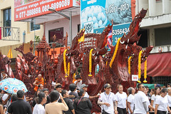 SURAT THANI,THAILAND ,OCTOBER 17,2016: Barge is decorated on parades in Chak Phra Festival on October 17, 2016 in Suratthani, Thailand. Chak Phra is the traditional of buddhist festival in Suratthani. (aphichatchaiyamat) Tags: asia asian belief believe boat buddha buddhism carving chak chakphra chakpra culture duan east event faith famous gathering leave meditation merit monk offering orange ornament parade people phra pra pray pull religion religious senior sib sunset suphannahong surat suratthani temple thai thailand thani tradition traditional twilight white work worship year
