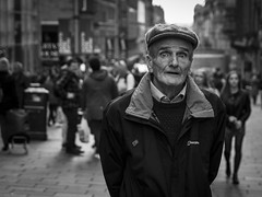A Little Surprised (Leanne Boulton) Tags: people monochrome depthoffield outdoor urban street candid portrait portraiture streetphotography candidstreetphotography candidportrait eyecontact candideyecontact streetlife man male old age elderly face facial expression look emotion feeling surprise surprised shock shocked eyes tone texture detail flatcap bokeh natural light shade shadow perspective city scene human life living humanity society culture canon 7d 50mm black white blackwhite bw mono blackandwhite character glasgow scotland uk
