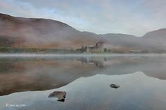 Shrouded In Mystery (jeanette_lea) Tags: kilchurn castle loch awe scotland sunrise mist sky clouds colours light reflections rocks trees