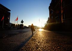 Sunset in Helsingborg, Sweden (` Toshio ') Tags: toshio sweden europe european europeanunion helsingborg sunset city cityhall woman silhouette statue sun sidewalk fujixe2 xe2 pattern