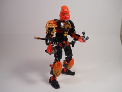 Ahi, Sheathed (MySnailEatsPizza) Tags: lego bionicle toa guardian robot sword buster laser light saber lightsager lightsaber gold black orange armor okoto lava fire flame v3 technic ccbs bbs system moc mysnaileatspizza