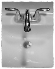 Quiet place (SixthOrder) Tags: monochrome blackandwhite bw chrome spotmatic pentax sink shop tattoo hp5 ilford studio