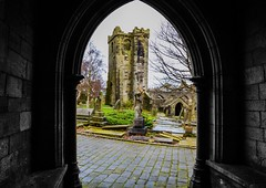 The old church from the porch of the new church (rustyruth1959) Tags: nikon nikond3200 tamron16300mm yorkshire heptonstall porch arch architecture building ruin structure tower church churchyard graveyard cobbles churchofstthomastheapostle churchofstthomasabecket green tree stones statue figure entrance opening village calderdale