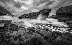 Black and White Coast (dkphotographs) Tags: ocean longexposure sea wild england blackandwhite white storm black art water weather rock clouds bay coast blackwhite waves northdevon stonebeach ndfilter wildsea sonyalpha57